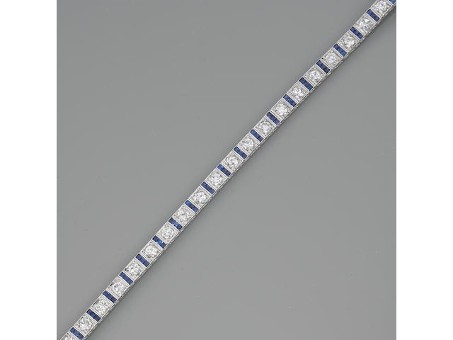 A diamond, sapphire and platinum line bracelet