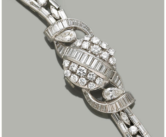 A lady's diamond and platinum covered wristwatch