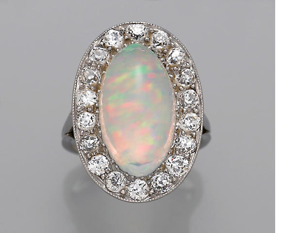 A crystal opal, diamond and platinum ring