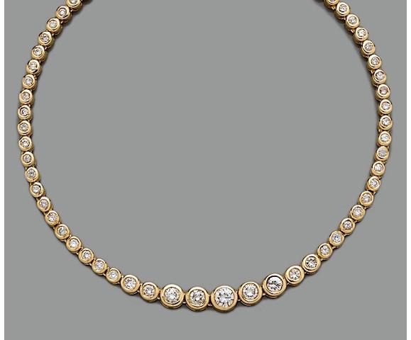 A diamond and fourteen karat gold rivière necklace