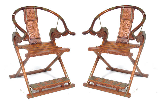 A pair of Chinese brass mounted horseshoe back armchairs
