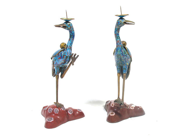 A pair of Chinese cloisonne figural candlesticks