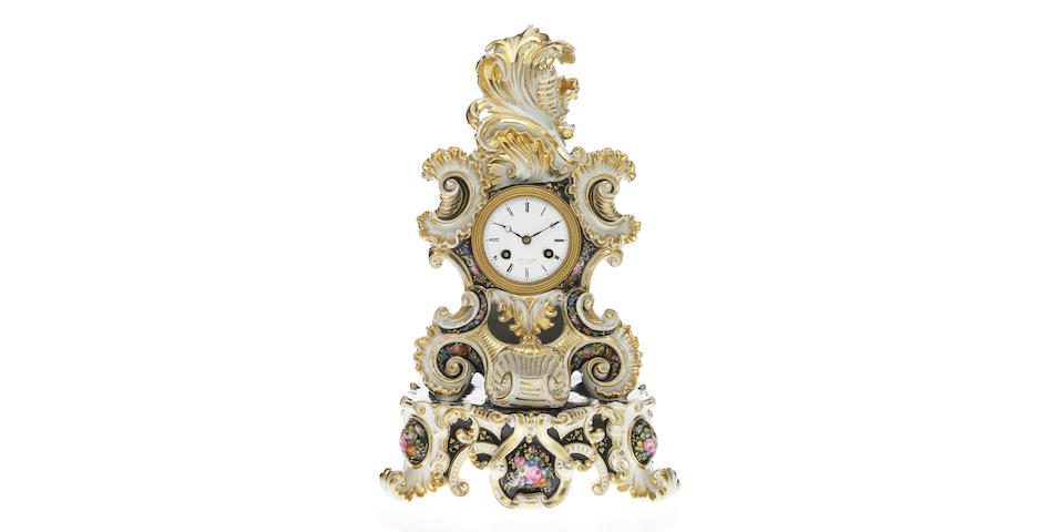 A French Jacob Petite style porcelain mantel clock