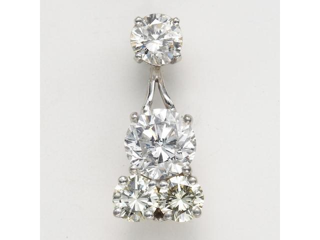 A diamond and fourteen karat gold brooch