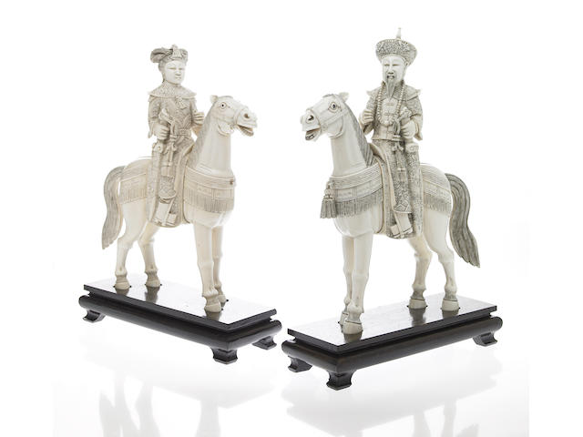 A pair of Chinese pieced ivory Emperor and Empress figures on horseback