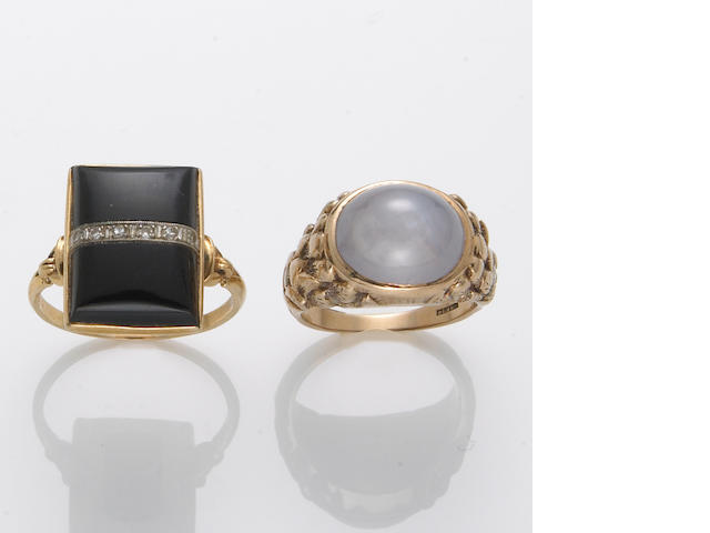 A star sapphire and 14k gold ring together with a diamond, black onyx, and 10k gold ring