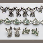 A two set collection of Mexican and sterling silver necklace and earrings