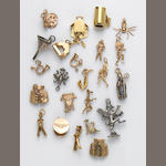 A collection of 18k, 14k, 10k gold, silver and metal charms