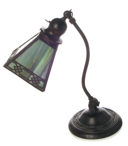 A Handel patinated-metal and slag glass piano lamp
