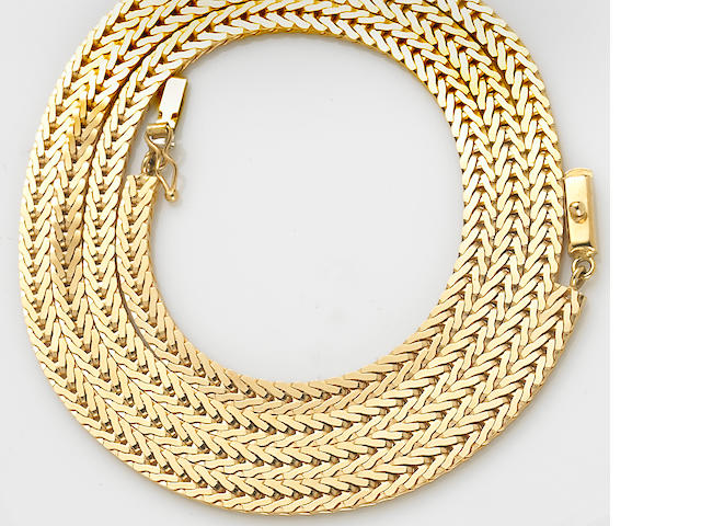 An 18k gold wheat link chain necklace