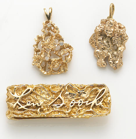 A collection of diamond and 14k gold nugget jewelry