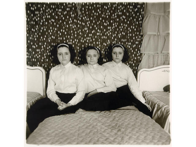 Diane Arbus (American, 1923-1971); Triplets in their Bedroom, New Jersey;