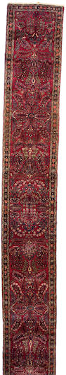 A Hamadan runner Central Persia, size approximately 2ft. 9in. x 20ft. 1in.
