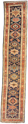 A Persian runner Persia, size approximately 3ft. 3in. x 17ft. 2in.