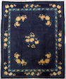 A Chinese rug China size approximately 9ft. 6in. x 8ft.