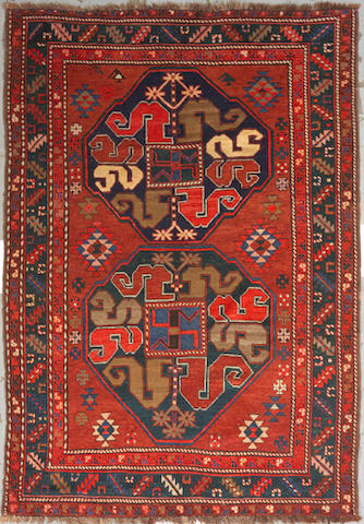 A Kazak rug Caucasus, size Approximately 4ft. 10in. x 6ft. 11in.