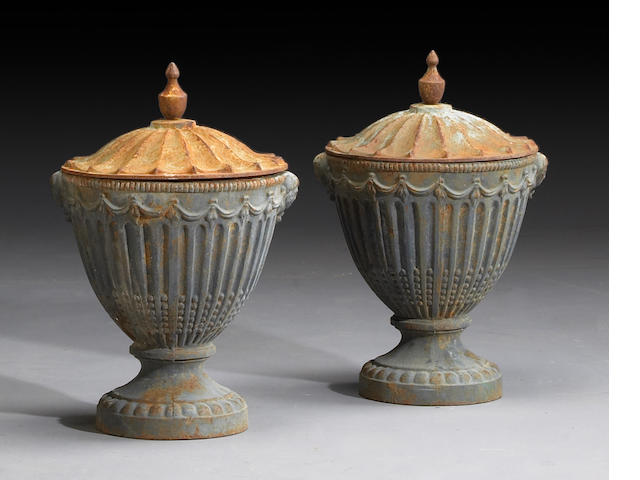 A pair of George III style painted cast iron garden urns