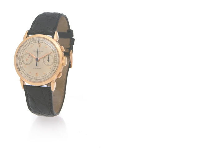 Patek Philippe. A fine and rare 18k pink gold chronograph wristwatch with prominent lugs retailed by Gobbi, Milano Ref.1579,