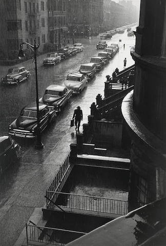 Ruth Orkin (American, 1921-1985); Man in Rain...from My Window on West 88th Street;