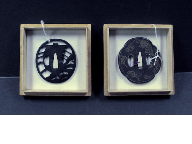 Two cast iron tsuba