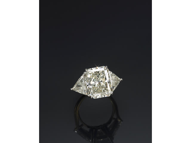 A diamond, eighteen karat gold and platinum solitaire ring