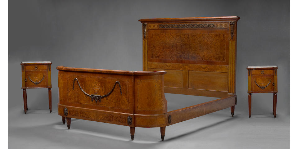 A French gilt bronze mounted inlaid burlwood bedroom set