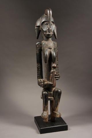 A Senufo maternity figure