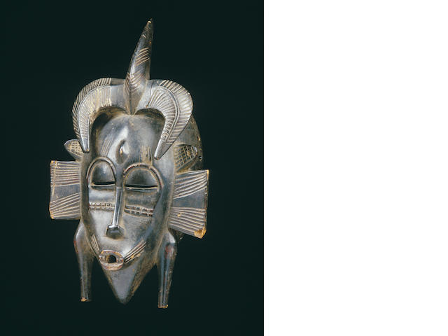 A Senufo facemask, Kpellie
