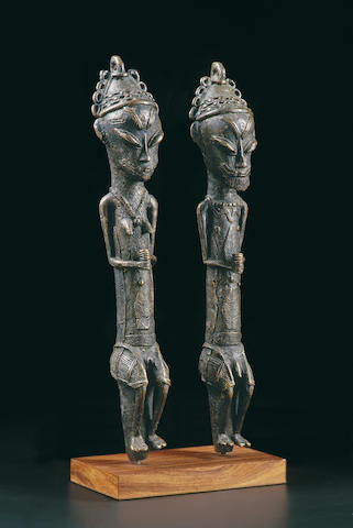 A pair of Yoruba bronze Ogboni staves, Edan