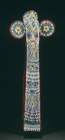 A Bamimileke cloth and beaded mask