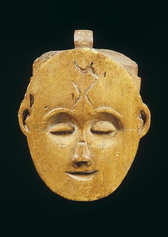 A fragment form a Fang janus helmet mask