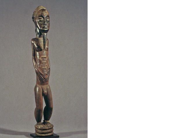A fine and rare Baule male figure