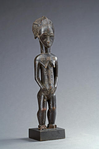 A Baule female figure