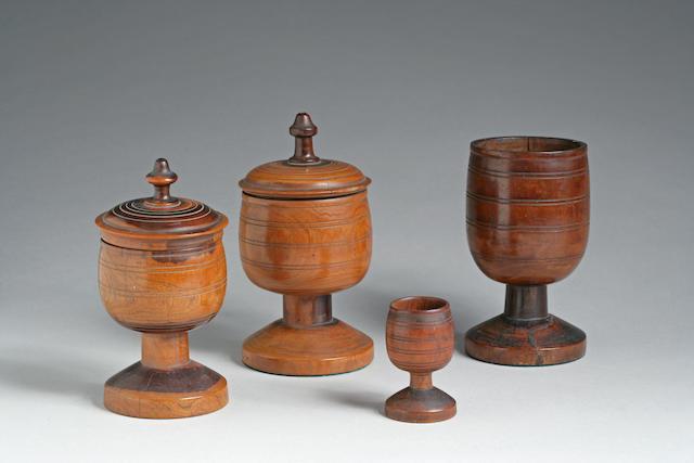 Four turned Hawaiian cups
