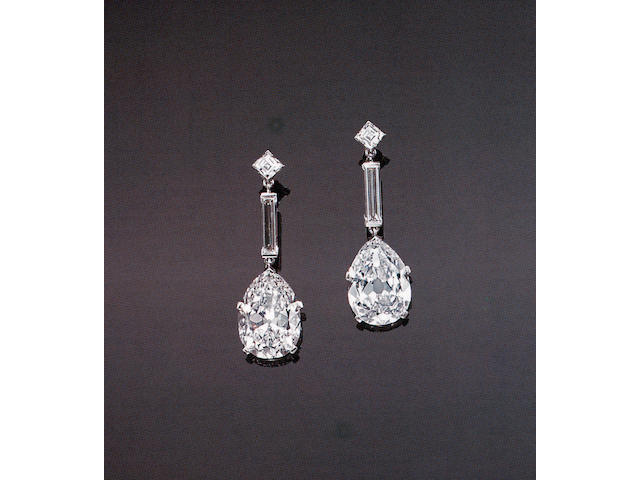 An impressive pair of diamond and platinum drop