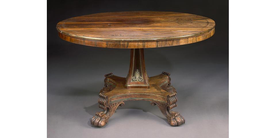 A Regency brass mounted rosewood breakfast table