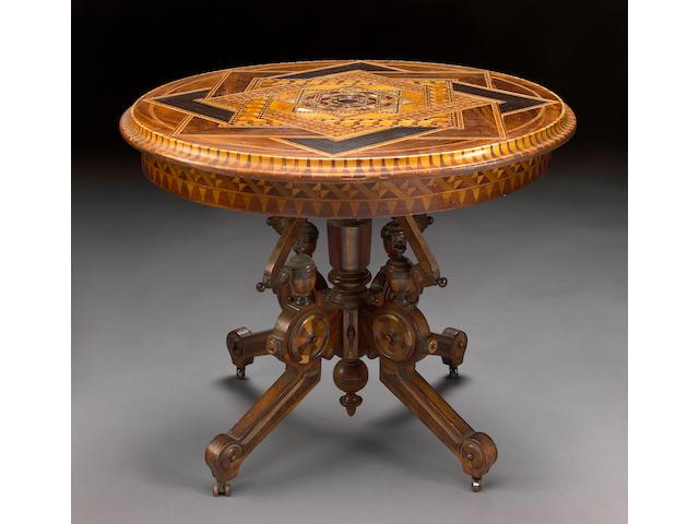 An Italian Aesthetic inlaid walnut center table