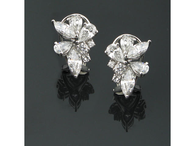 A pair of diamond and 18k white gold earrings,