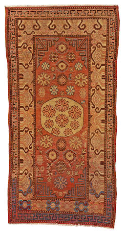 A Khotan rug Turkestan, size approximately 4ft. x 7ft. 6in.
