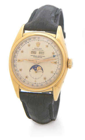 Rolex. A rare 18k gold self-winding triple calendar wristwatch with phases of the moon