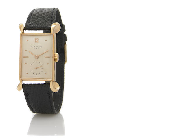 Patek Philippe. A fine and unusual 18k rose gold rectangular wristwatch with oversize sculpted lugs Ref.2414, Case No.511320, Movement No.971541, circa 1947