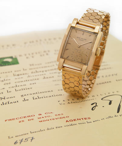Patek Philippe, retailed by Frecco. A fine and rare 18k pink gold large rectangular wristwatch on 18k pink gold bracelet Ref.2443, Case No.512014, Movement No.973318, made circa 1951