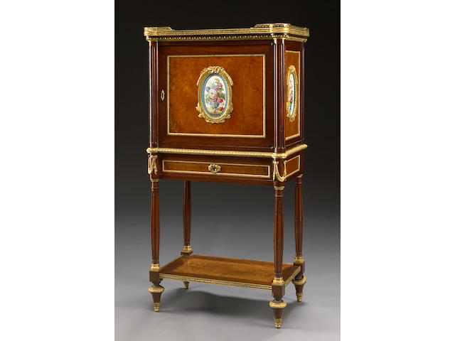A Louis XVI style gilt bronze and porcelain mounted amboyna and mahogany cabinet
