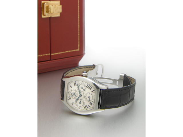 Cartier. A fine platinum limited edition tonneau-shape dual time zone perpetual calendar wristwatch with leap year indicator Tortue Perpetual Calendar, Ref.2646, No.037, made in 2001
