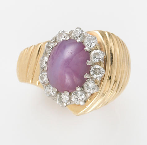 A purple star sapphire, diamond and 14k gold ring