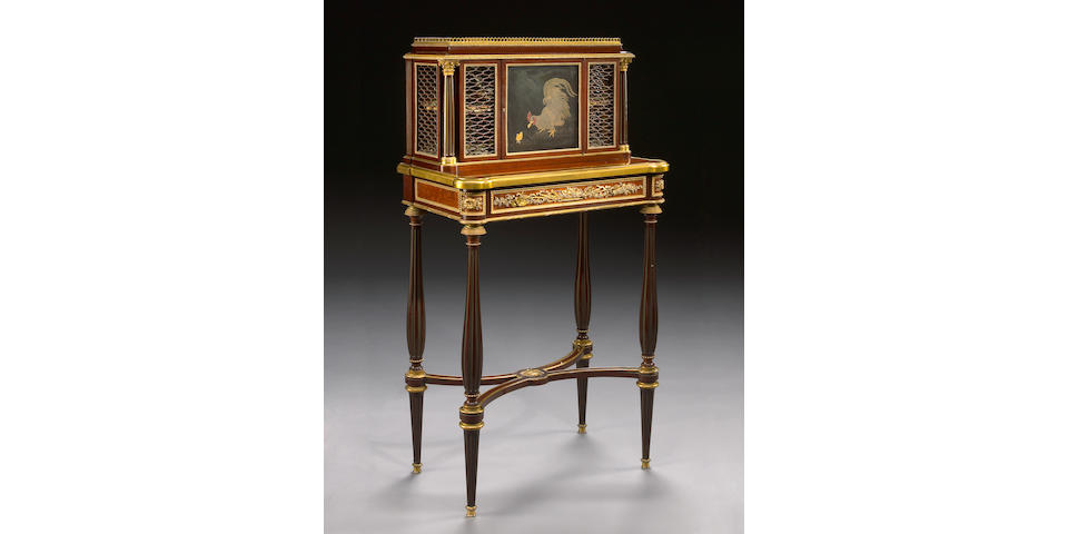 A Louis XVI style gilt bronze mounted amboyna inlaid mahogany bonheur du jour