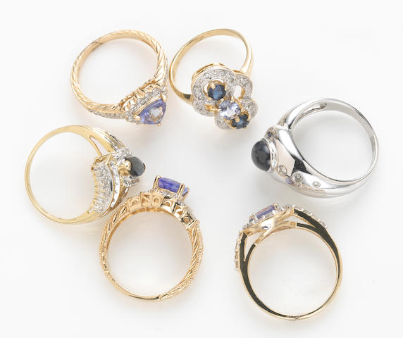 A collection of six tanzanite, sapphire, synthetic star sapphire, diamond, white topaz, 14k and 10k gold rings