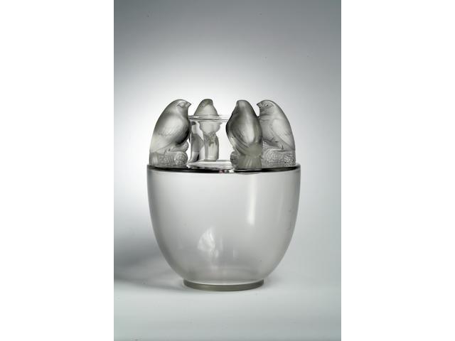 A René Lalique molded clear glass vase: Bellecour