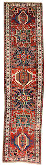A Heriz runner Northwest Persia, size approximately 3ft. 4in. x 13ft. 6in.