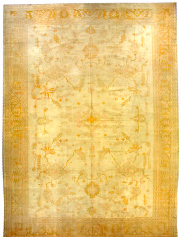 An Oushak carpet West Anatolia, size approximately 13ft. 7in. x 18ft. 7in.